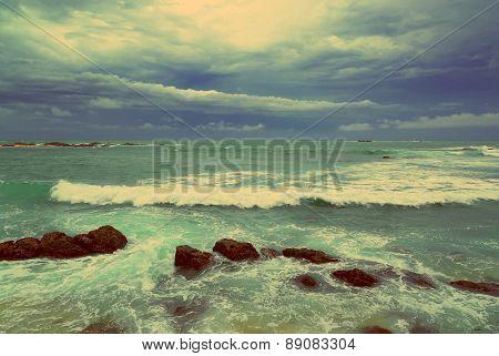 Beautiful sea stormy landscape over rocky coastline in Indian ocean - vintage retro style