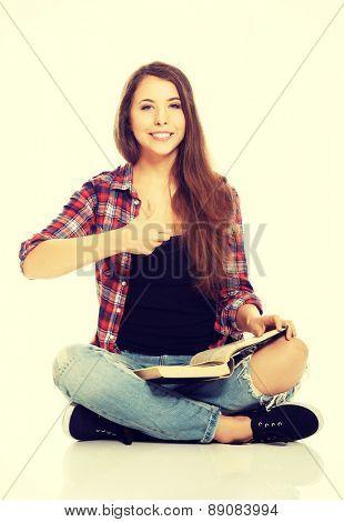 Woman sitting cross-legged and reading