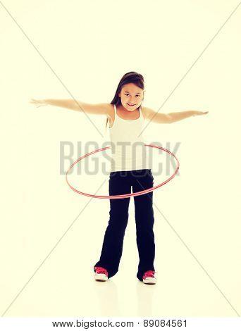 Happy little girl with hula hoop