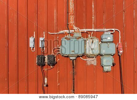 Electric Junction Boxes, Retro Style On Red Wall