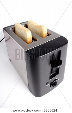 Close-up of toaster on white background