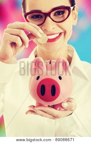 Young businesswoman holding a piggybank