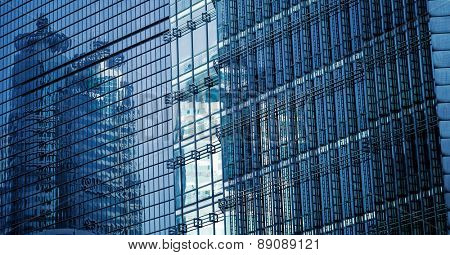 facade of modern office building, blue toned images.