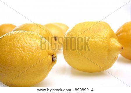 Close-up of lemons on white background