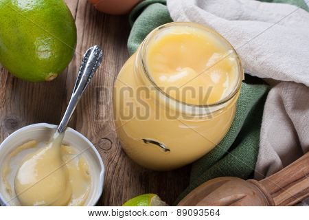 Homemade lime curd in glass jar