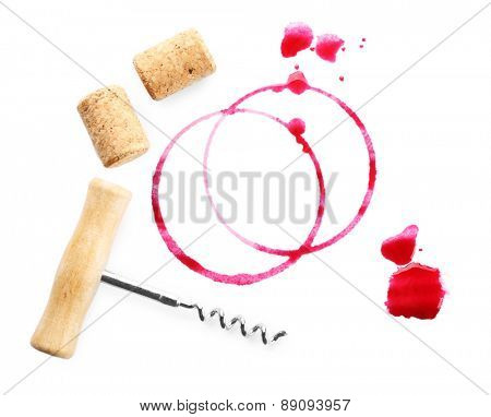 Wine stains, corks and corkscrew  isolated on white
