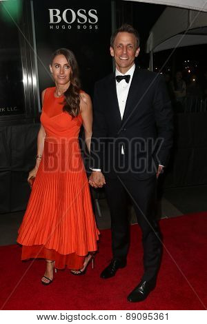NEW YORK-APR 21: TV host Seth Meyers (R) and wife Alexi Ashe attend the 2015 Time 100 Gala at Frederick P. Rose Hall, Jazz at Lincoln Center on April 21, 2015 in New York City.