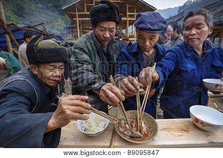 Sharing Food At Village Festival, Villagers Celebrate Beginning Of Construction