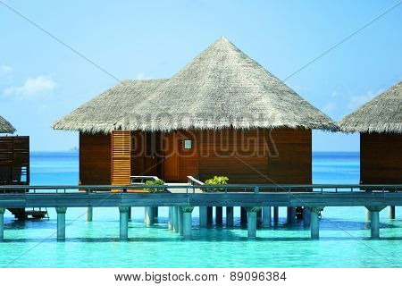 Water villas over blue ocean in Baros Maldives