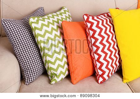 Colorful pillows on sofa close up