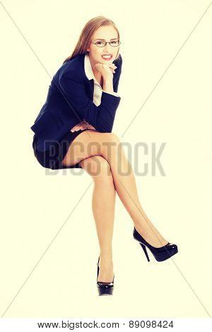 Beautiful young blonde businesswoman sitting