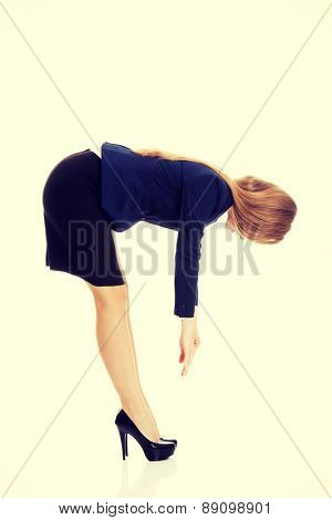 Young business woman bend down