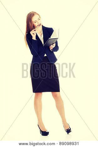 Young businesswoman wondering about project