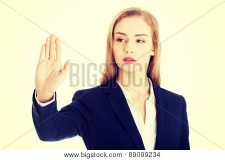 Beautiful businesswoman making stop sign