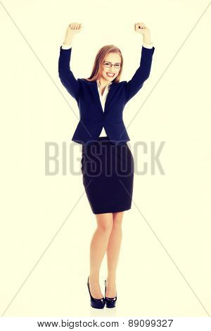 Young beautiful blonde businesswoman cheering