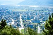 stock photo of albania  - Modern part of Berat city with University in Albania - JPG
