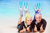 picture of flipper  - Joyful diver couple lying down on the beach - JPG