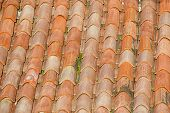stock photo of uniqueness  - View of unique weathered terracotta roof of a Mediterranean house - JPG