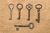 stock photo of hasp  - A lot vintage keys to the safe on a old cloth - JPG