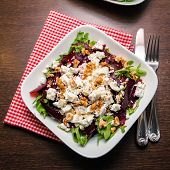 picture of beet  - upper view of a beet salad with arugula feta cheese and walnut - JPG