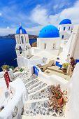 pic of greek-island  - Blue domed churches on the Caldera at Oia on the Greek Island of Santorini - JPG