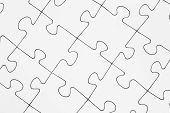 stock photo of jigsaw  - White connected jigsaw pieces Jigsaw and puzzles concepts - JPG