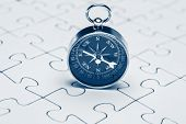 picture of jigsaw  - Compass on jigsaw Jigsaw and puzzles concepts  - JPG