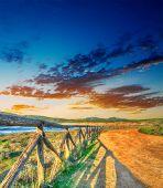 stock photo of shoreline  - colorful sunset by Porto Ferro shoreline - JPG