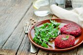 stock photo of quinoa  - chickpeas quinoa and beet burgers with arugula on a dark wood background - JPG
