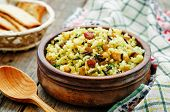 picture of rice  - rice wild rice chickpeas with raisins and herbs on a dark wood background - JPG