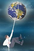 picture of twinkle  - Businessman pulling a rope against stars twinkling in night sky - JPG