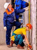 stock photo of millwright  - Happy group people in builder uniform indoor - JPG