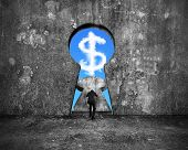 foto of keyholes  - Businessman pushing keyhole door with sky dollar sign shape cloud view on mottled concrete wall background - JPG