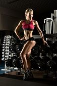 picture of execution  - beautiful girl bodybuilder execute exercise with weight - JPG