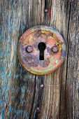 picture of keyhole  - Old keyhole on aged wooden door - JPG