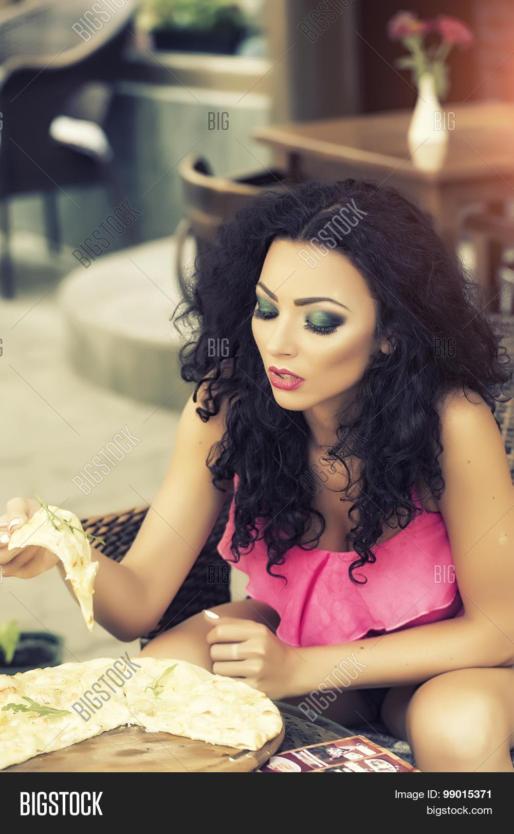 Black girl eating pizza