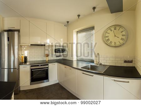 Retro Wall Clock In Kitchen
