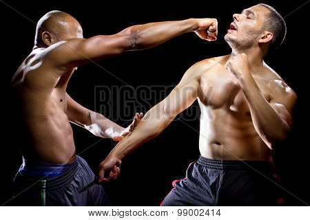 Martial Arts Instructor Demonstrating Knife Self Defense