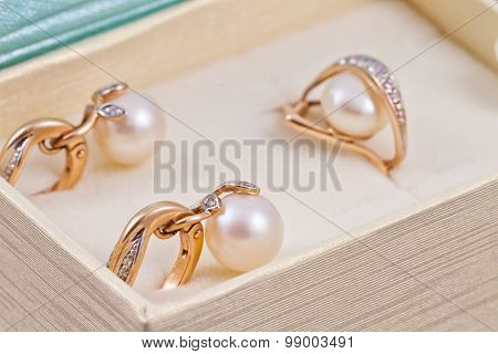 Set Of Gold Earrings And Rings With Pearls