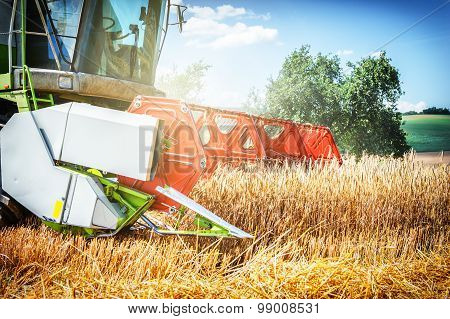 Combine Harvester Working At Wheat Field