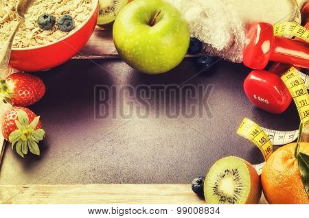 Fitness Frame With Dumbbells And Fresh Fruits. Healthy Lifestyle Concept