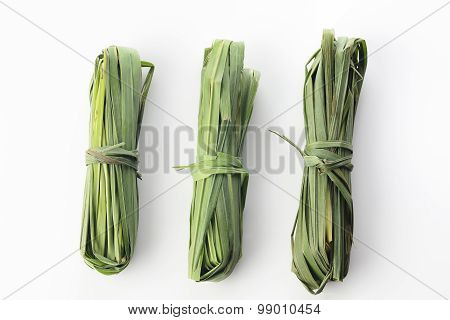 Three Bunches of Fresh Green Lemon Grass On White Background