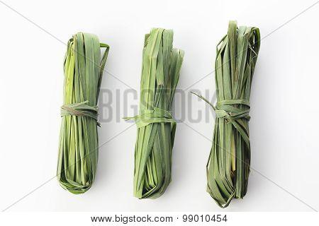 Three Bunches of Fresh Green Lemon Grass On White Background