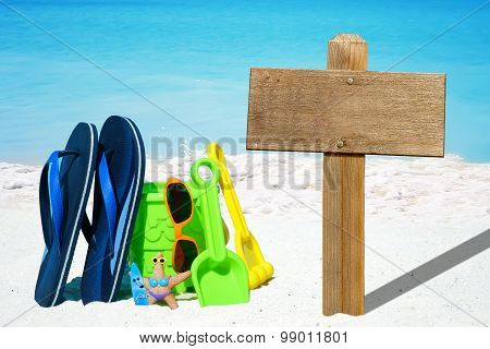 Beach Toys And Emty Wooden Signboard