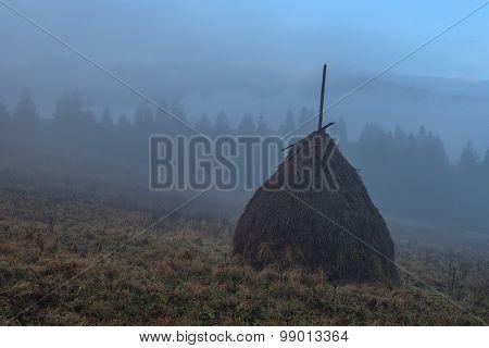 Amazing rural scene on autumn valley. Alone haystack on a foreground. Carpathians, Ukraine, Europe.