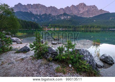 Fantastic sunrise on mountain lake Eibsee, located in the Bavaria, Germany. Dramatic unusual scene. Alps, Europe.