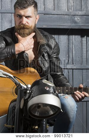 Biker Man With Guitar