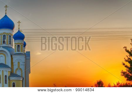 Christian church with blue domes and golden crosses against the