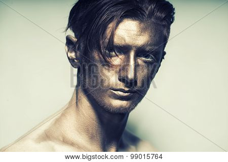 Man With Bronze Face