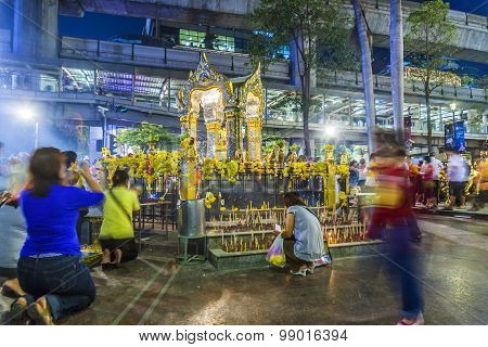People At Famous Erawan Shrine In Bangkok